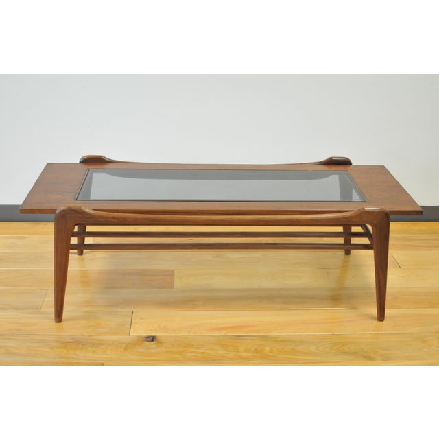 Gorgeous mid century modern wood and glass coffee table. Lovely lines and curves true to the beauty of mid century...