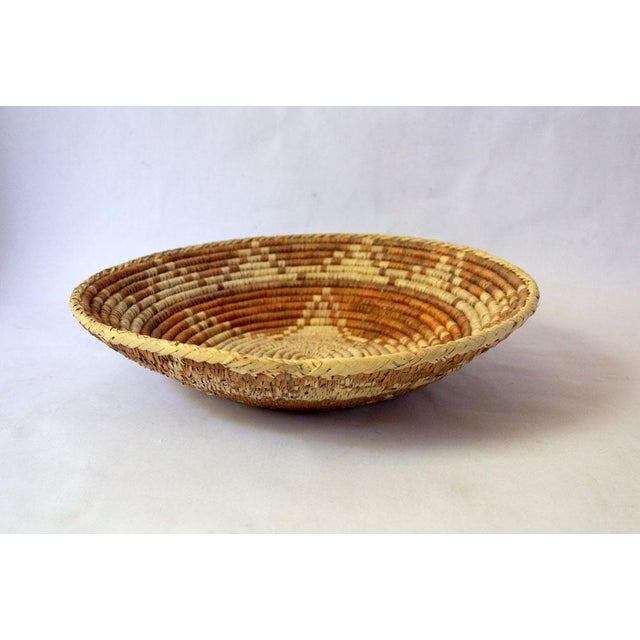 20th century handwoven basket with star motif in neutral tones. Beautiful in many roles; as a fruit basket, corralling...
