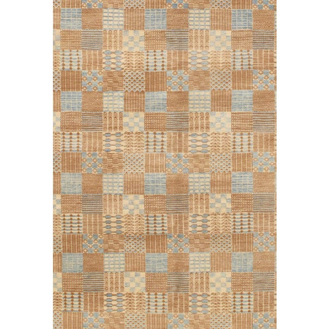 This contemporary rug is from the Modern collection and features a border tan pattern. These rugs bring modern...