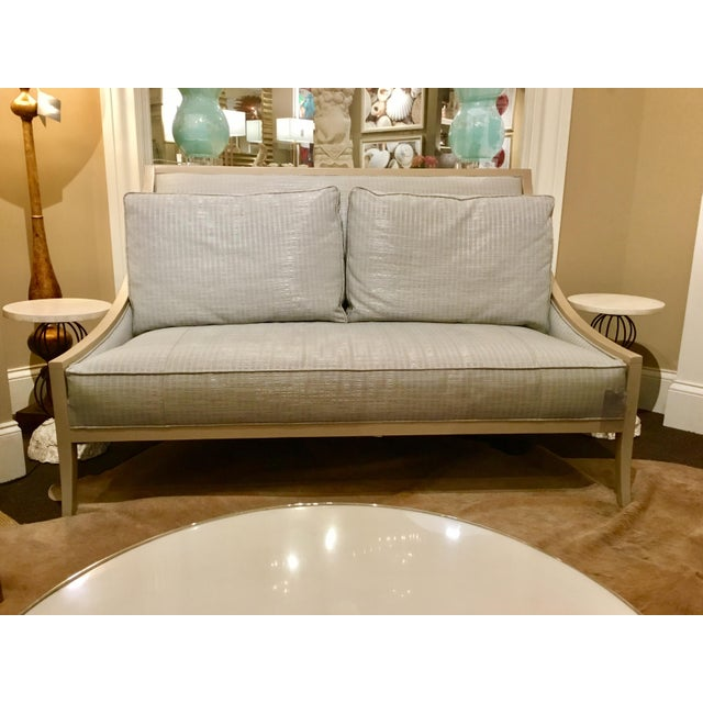 Caracole on the Line Sette with an elegant champagne wood frame and sleek soft blue sateen finished upholstery fabric,...