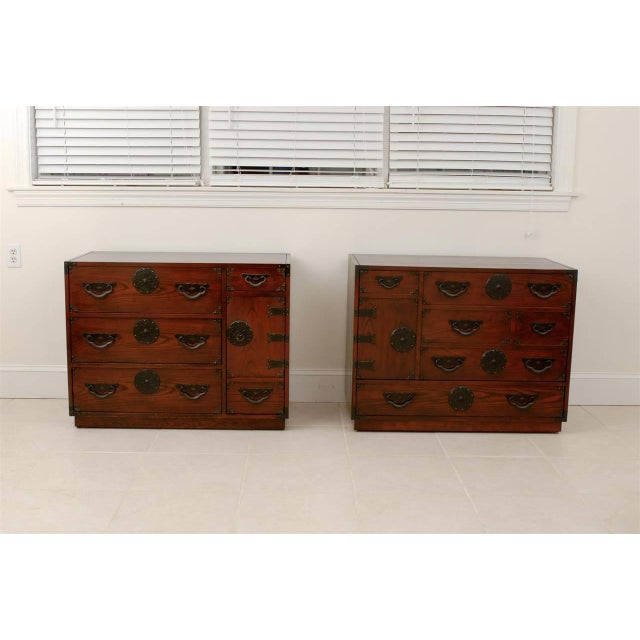"""A Fabulous modern interpretation of the traditional Japanese """" Tansu """" chest by Baker, circa 1970. Stained oak with..."""