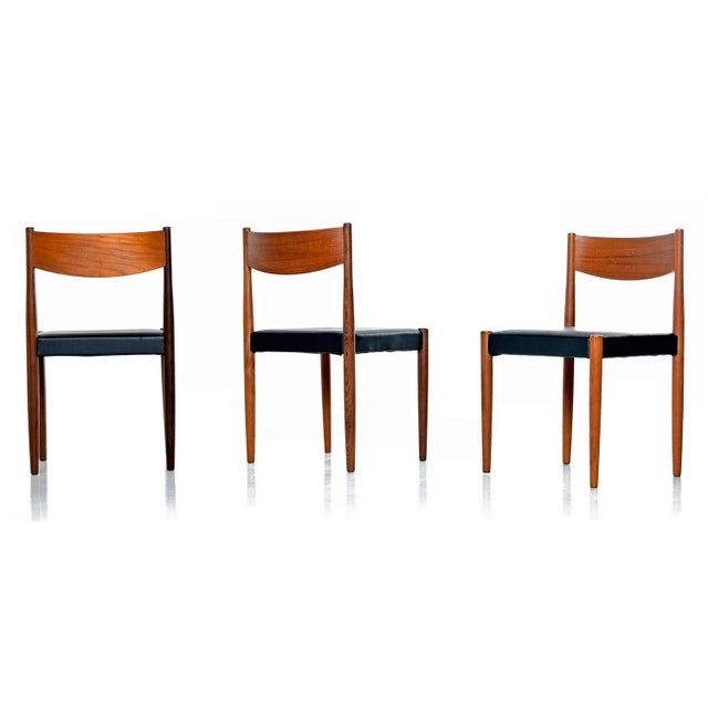 Fabulous group of six mid century Danish modern teak and rosewood dining Chairs. Graceful contouring in the teak backrest...
