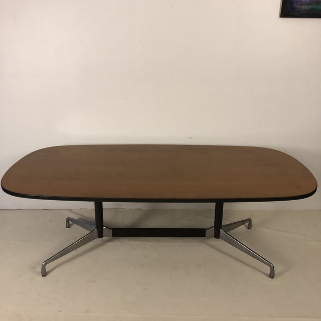 Ray and Charles Eames for Herman Miller aluminum group oval conference table. Walnut oval top with aluminum base....