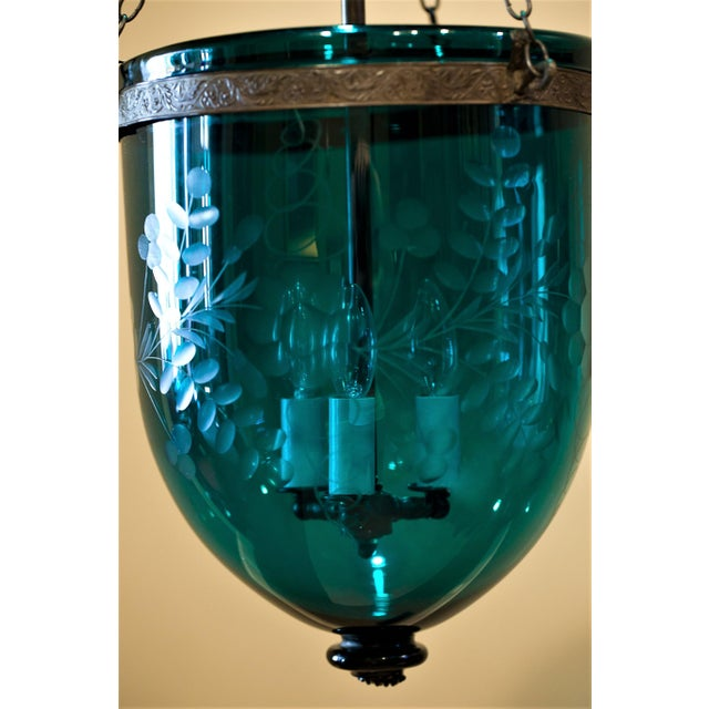 The glass is green with a slight bluish cast. Etched pattern of leaves and flowers. Smoke bell is original as is the...