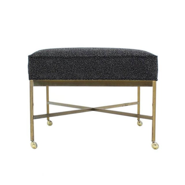 Nice Mid-Century Modern large solid brass ottoman with new upholstery in style of Paul McCobb.