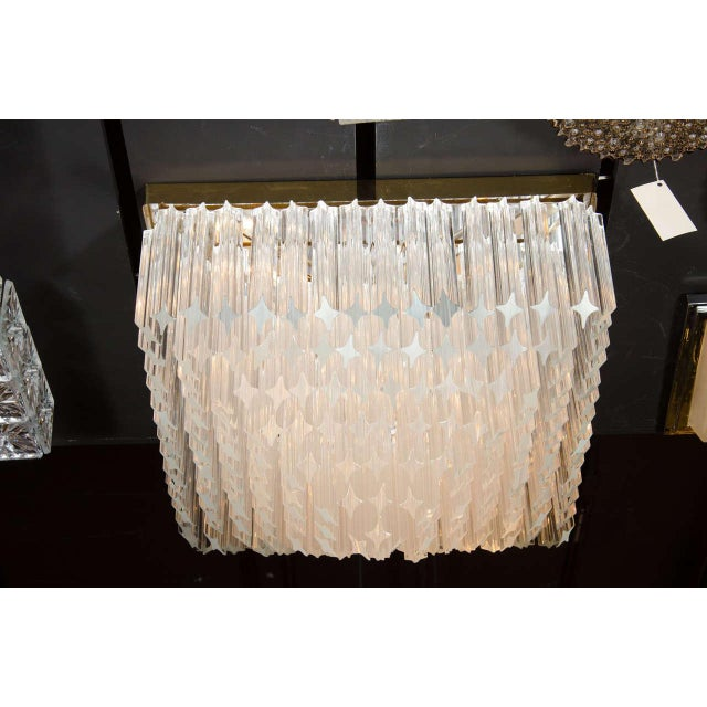This exceptional Mid-Century Modernist flush mount chandelier consists of angle cut triedre crystals suspended from a...