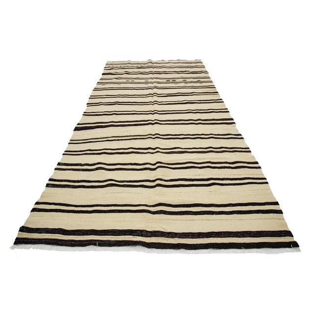 Handwoven striped vintage kilim rug from Afyon region of Turkey. Approximately 45-55 years old. In very good condition