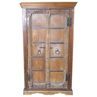 Antique Indian 19th Century Armoire With Metal Braces and Hand-Carved Decor For Sale