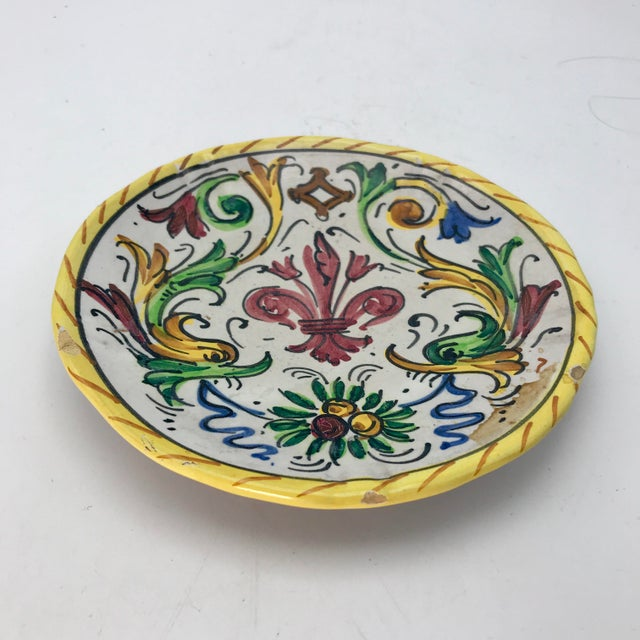 Lovely hand painted Deruta plate from 1890-1920 in the Majolica style of Raffaelesco. Italian folk art at its best....