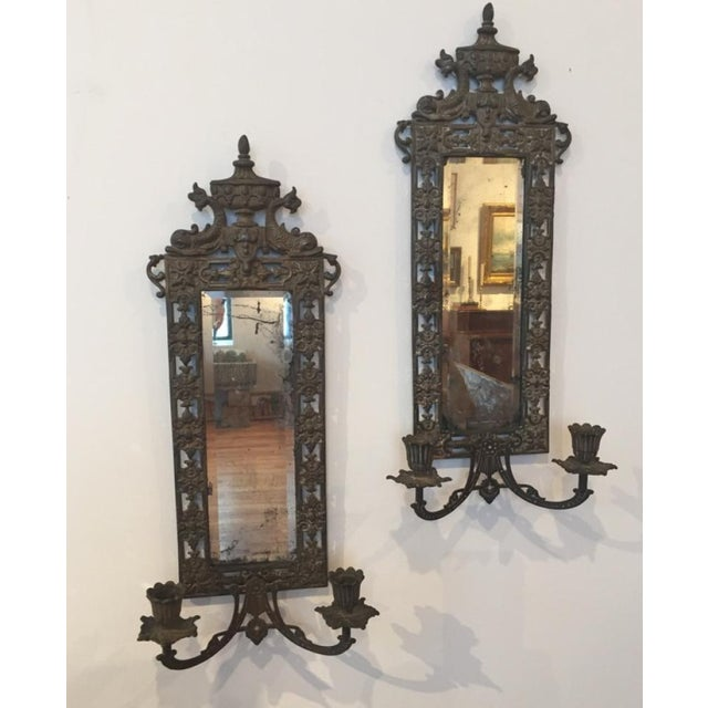 A fine pair of ornate Victorian sconces with old mirrored glass. Made in the mid 19th century