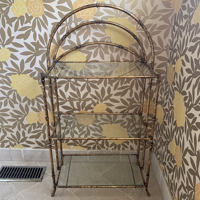 Gilt Metal Faux Bamboo Etagere. Perfect for a powder room. Three glass shelves included.