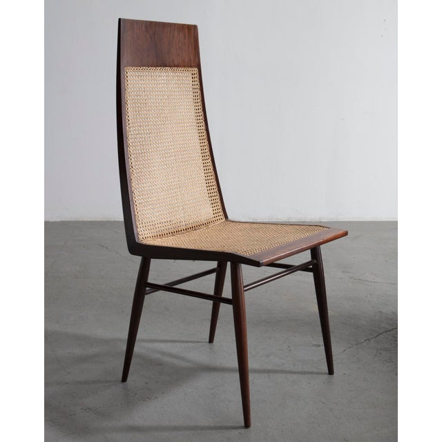 Set of eight (8) dining chairs in rosewood with cane seat and back. Designed by Joaquim Tenreiro, Brazil, circa 1949...