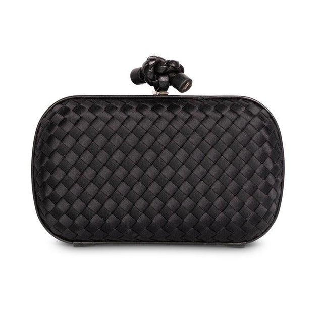 The Knot is one of Bottega Veneta's most beloved handbags. The rounded hardshell box clutch, based on an archival shape...