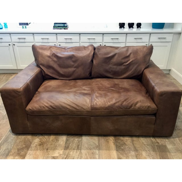 I got this buttery Restoration Cloud leather loveseat off the show room floor at Restoration Hardware in excellent...