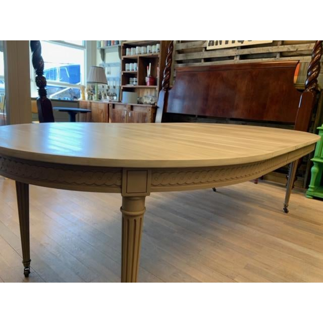 Fabulous 1950's Starburst Baker Furniture Three Leaf Dining Table. Professionally Painted. Brass Sabots on wheels, lovely...