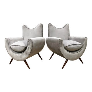 Chic Lounge Chairs in the Manner of Jean Royere - a Pair For Sale