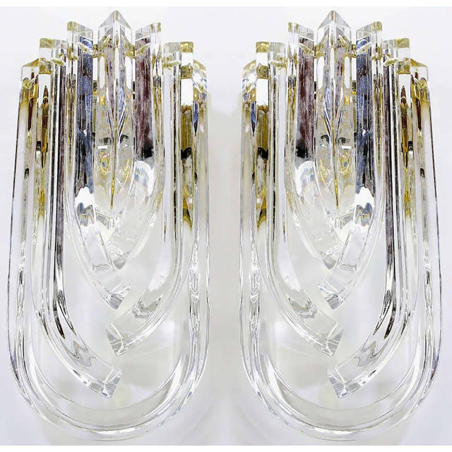 Outstanding and rare pair of Italian bent triangular crystal and brass wall sconces from Venini. One U-shape crystal with...