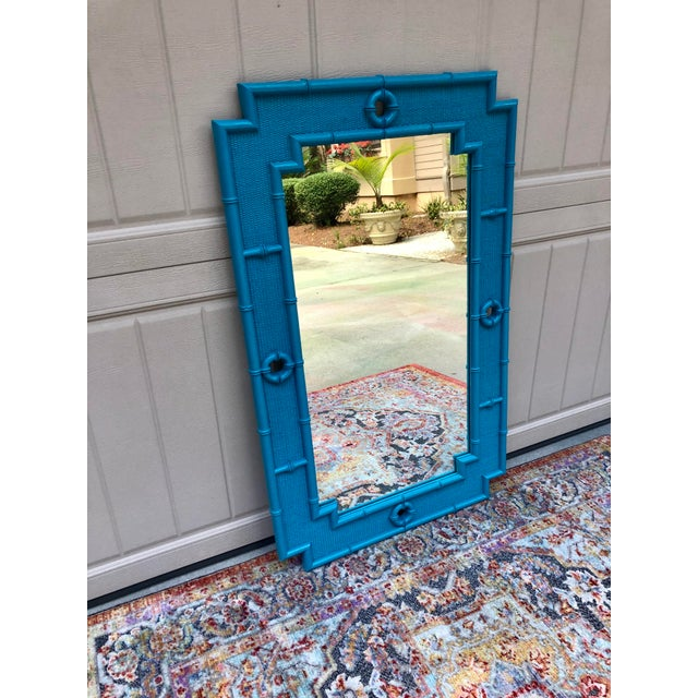 Bright jewel tone turquoise turns this vintage faux bamboo mirror into an updated treasure. Woven insets and round raised...