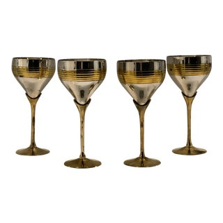 Set of Four Chrome and Brass Goblets