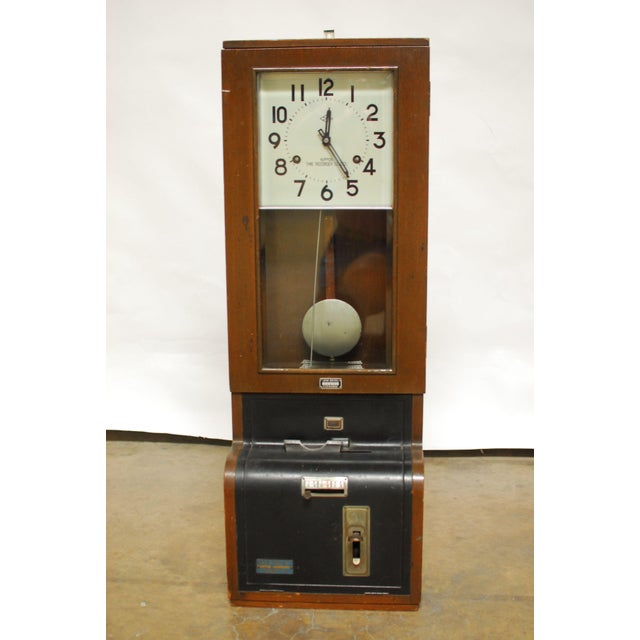 """An antique time recorder punch clock made in Japan by Nippon stamped """"Japan Central Exchange"""". Made of wood with beveled..."""