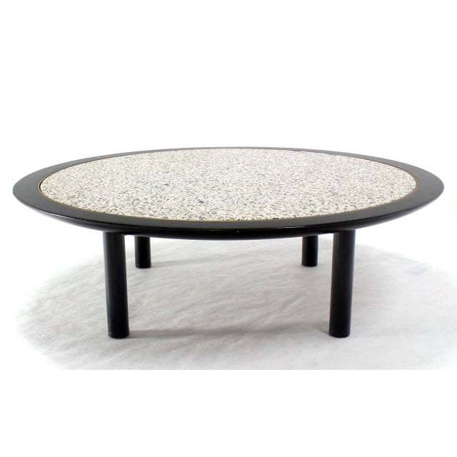 "Very nice quality round (48"") eboniesed base coffee table with granite not marble top by Baker."