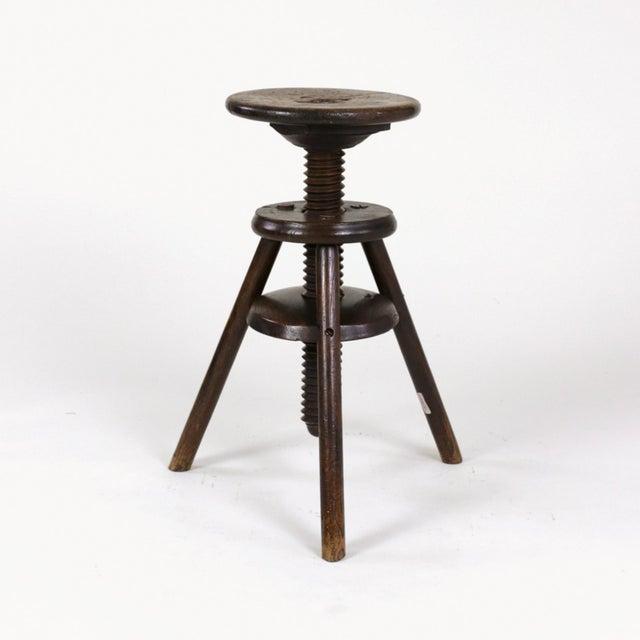 Oak three legged adjustable Artist stool, English circa 1870. Victorian revolving adjustable artist/work stool. A circular...