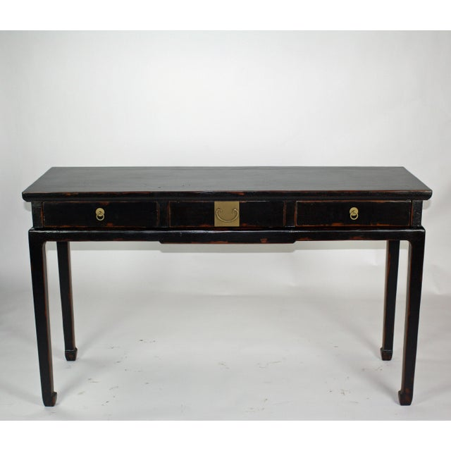 Decorated with muted antique black lacquer finish and distressed edges and top, this sideboard gives the beholder a sense...