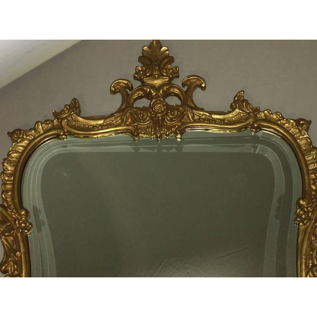 Pair of console or wall mirrors. Chippendale fashioned. Each center beveled frame mirror having a giltwood decorated...