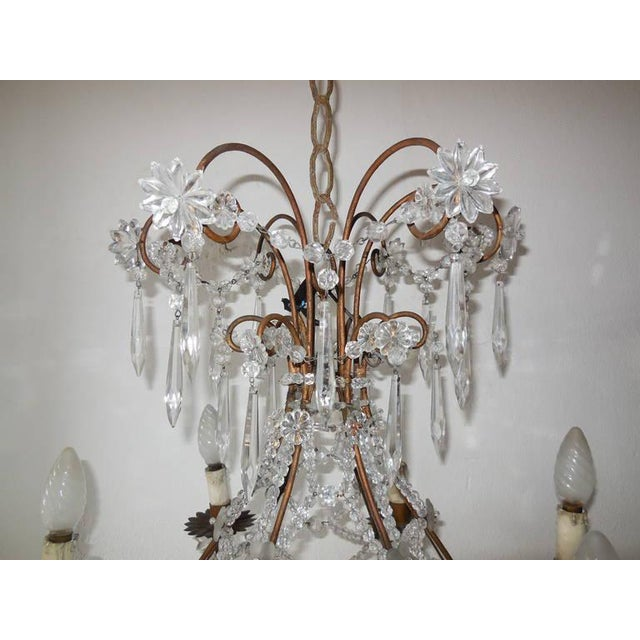 Housing an impressive 7 lights. Stars, balls, spars and flowers are all in crystal. Criss-cross beading. Flower florets,...