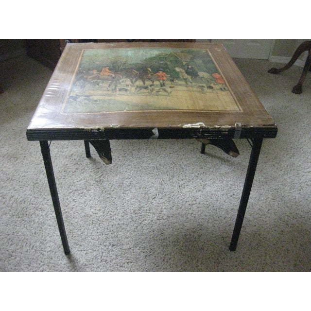 This Vintage Card Table has a lovely hunt scene with horses depicted on the top. The table folds up for storage and you...