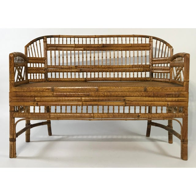 Absolutely gorgeous Brighton Pavillion style settee featuring natural finish and caned seat. Stunning Chinoiserie...