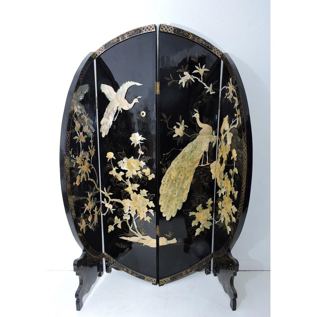 Stunning accent piece - a vintage black lacquer room divider or screen comprised of four panels, unusual round form. The...