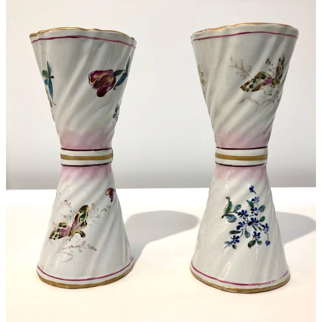 A charming pair of handcrafted flower vases, late 19th century fine French majolica, characterized by an unusual conical...