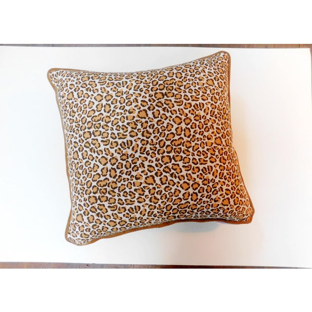 This pillow will add a wild flair to your bedroom or living room. Features a Camel Velvet piping. Has a zipper to remove...