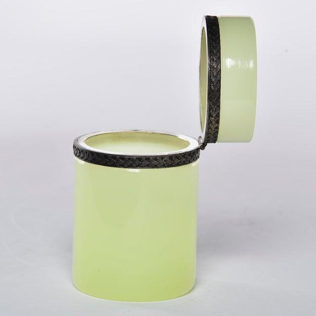 Circa 1920s French uranium opaline glass cylindrical hinged box has brass trim. Unknown maker.