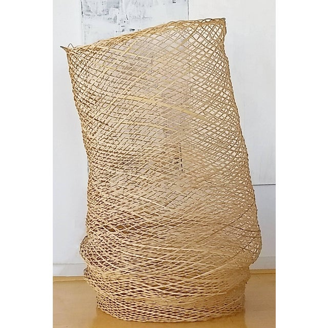 """For your consideration is a great, woven floor sculpture of a basket. In excellent condition. The dimensions are 28"""" W x..."""