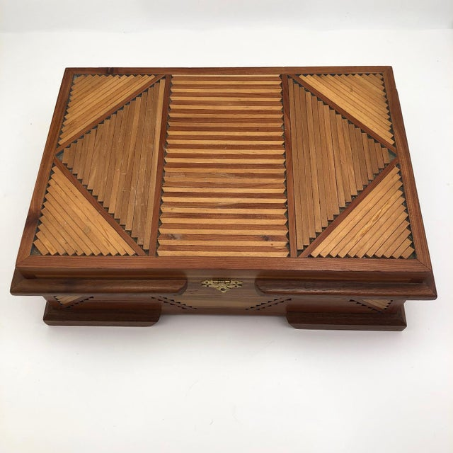 Super sharp and with not a single bit of wood missing or out of place, I think this vintage tramp art jewelry box is quite...