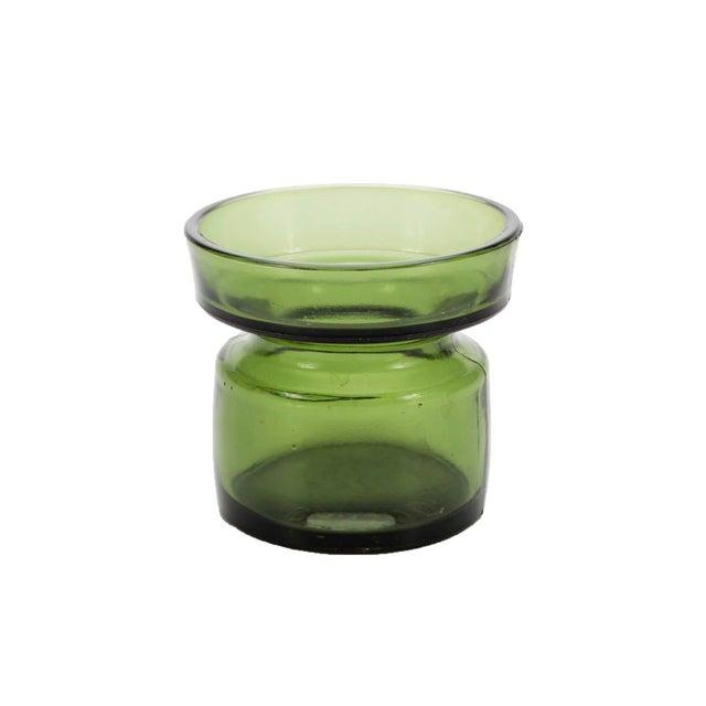 Set of four green glass candleholders by designer Jens Quistgaard for Dansk Designs, Denmark.