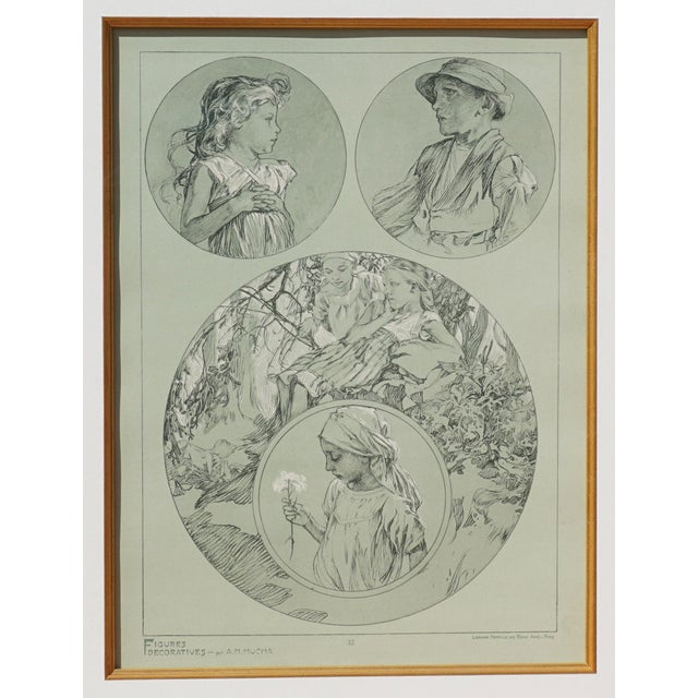 A framed Art Nouveau poster by Alphone Mucha from 1905 representing Muchas sketched designs of nudes, girls and boys in...