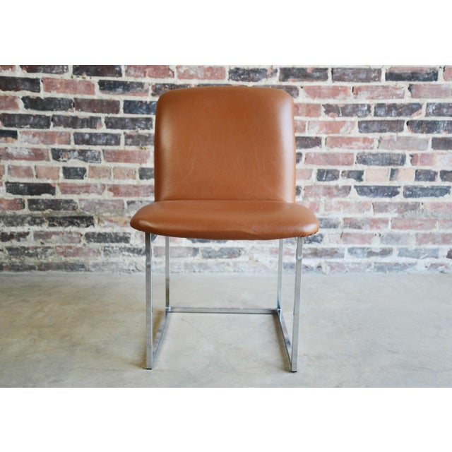 Two stunning chrome and vinyl side chairs. They are in beautiful original condition.