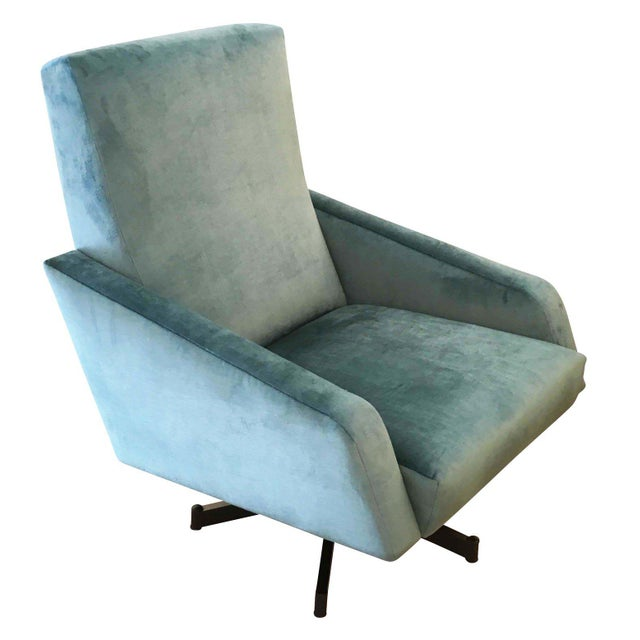 Elegant pair of swivel lounge chairs characterized by straight and diagonal lines. Very comfortable, the seat is on a...