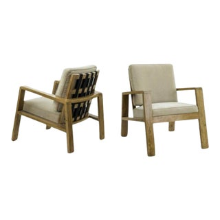Jean Royere Pair of Documented Oak Slender Lounge Chairs For Sale