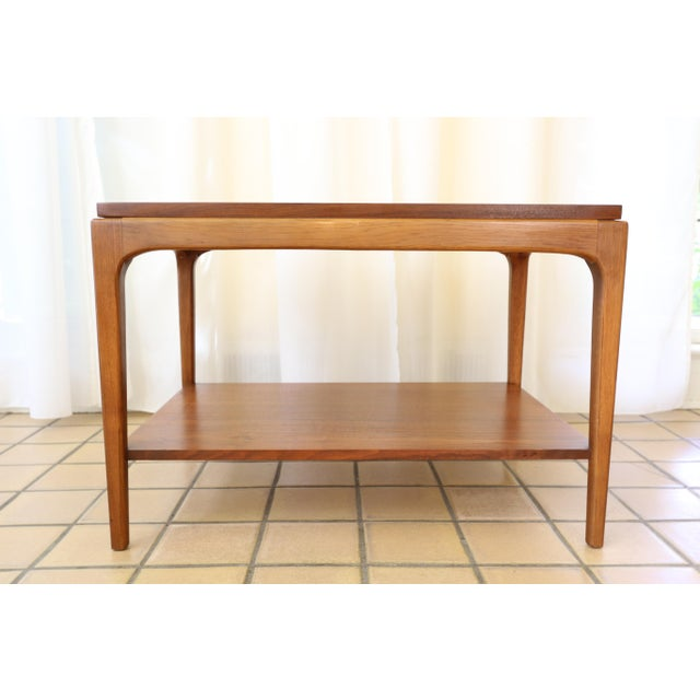 This 1963 Rhythm side / end table has the hallmarks of Lane craftsmanship: tapered legs, clean and elegant lines, walnut...