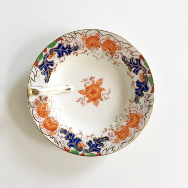This wonderfully colorful vintage candy dish is hand painted in Japan. It is in excellent condition with gold trim.