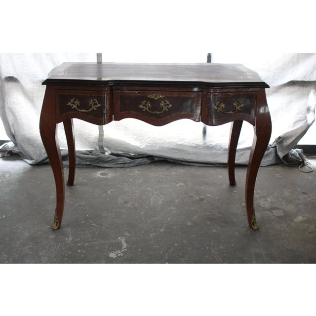 Beautiful detailed 19th century boulle desk with gold brass handles. Amazing gold detailing on wood. A unique find....