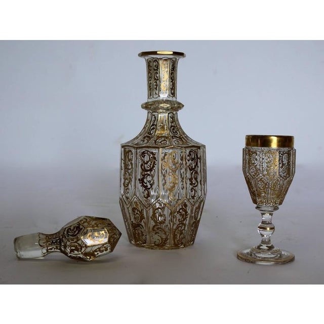 Antique 24-karat heavily gilded Baccarat decanter with a matching shot glass. Cup dimensions: H x 3.75 inches W x 1.75...