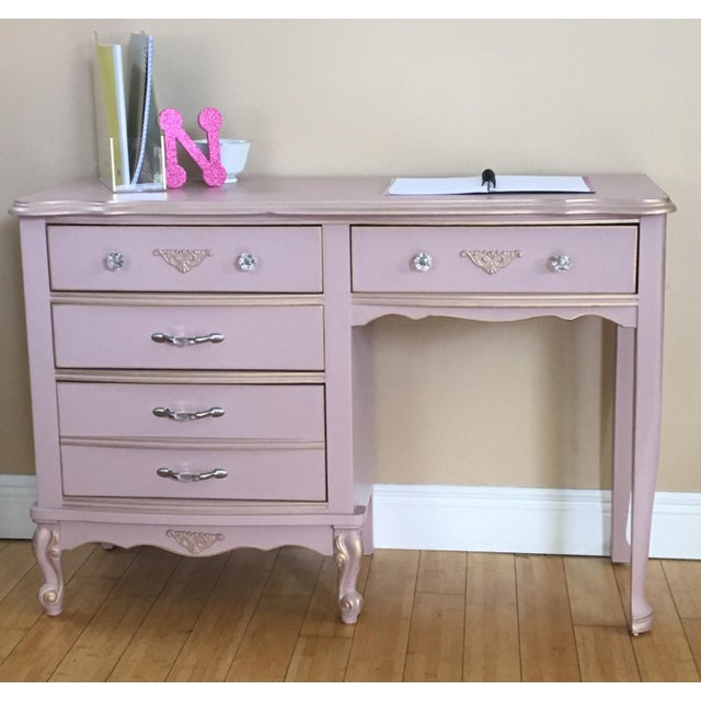 Beautiful versatile piece can be used as a desk, a changing table or a vanity. This piece can literally grow up with your...