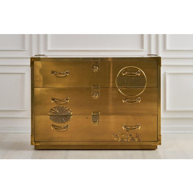 A rare and remarkable brass clad three drawer dresser attributed to Mastercraft. Featuring the iconic Mastercraft patina...