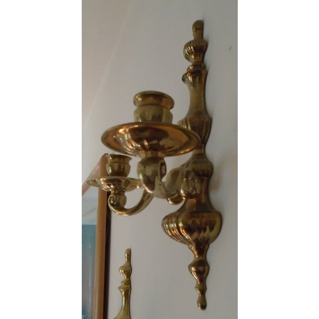 Pair of matching 2 candles wall sconces. Made of brass in the mid-20th century. In the style of Art Nouveau