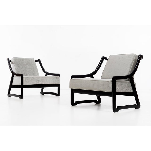 Paul Laszlo attributed lounges, solid black painted wood restored with reupholstered seats in cotton velvet.